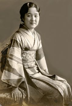 """Seated portrait of a mother.  About 1920's, Japan. Photographic studio: """"S. ESAKI SHIBUYA"""""""