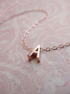 Tiny rose gold letter necklace - Rose gold initial on rose gold filled chain. $37.00, via Etsy.