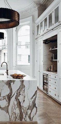 Such an artistic marble waterfall counter-top and pendant.
