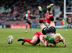 Matt Hopper of Quins is upended during the LV= Cup match between Harlequins and London Welsh at Twickenham Stoop on January 2013 in London, England. London Welsh, January 26, Sports Photos, London England, Rugby, Super Bowl, Surfing, Children, Image