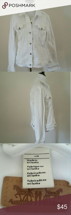 WOMEN'S LEVI WHITE DENIM JACKET, SZ L WOMEN'S LEVI DENIM JACKET, SZ L, IN WHITE WITH SILVER TRIM ALONG POCKETS AND SLEEVES. Let this women's Levi's denim jacket fulfill your fashion needs. Princess seams flatter your figure, while adjustable button tabs at the waist provide the perfect fit. Product Features Button front Long sleeves 4-pocket Levi's Jackets & Coats Jean Jackets
