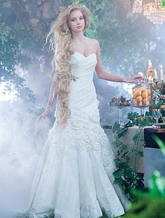 A woman wearing the Rapunzel wedding gown from the Alfred Angelo Bridal Collection Disney Inspired Wedding Dresses, Princess Wedding Dresses, Wedding Dress Styles, Disney Weddings, Wedding Disney, Princess Gowns, Bridal Gowns, Wedding Gowns, Tangled Wedding