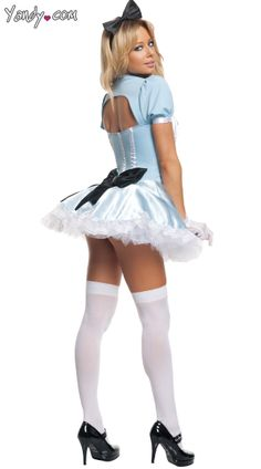 Party Alice costume includes a pale blue mini dress with cut out front and back detail, attached puff sleeves, collar, black satin bows, apron, oversized back bow, lace trim and black bow head band. (Stockings and petticoat not included.)