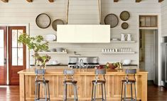 Open Kitchen with Shiplap Walls - 15 Ways with Shiplap - Southernliving. Tailored shiplap walls made of paint-grade wood contrast with the rough-hewn floors and ceiling. The wall's subtle hue (Lambswool by Pratt Modern Farmhouse, Farmhouse Kitchen Decor, Home Decor Kitchen, Farmhouse Style, Kitchen Ideas, Modern Rustic, Southern Farmhouse, Craftsman Kitchen, White Farmhouse