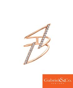 A fashionable 14k Pink Gold Diamond Ring by Gabriel and Co to go with any nude outfit. We love how sharp and dramatic this trendy diamond ring is. With all the little diamonds on the stunning design, this ring is absolutely perfect.