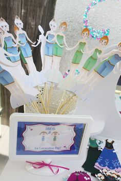 Frozen Inspired Coronation Party ... dress up paper dolls