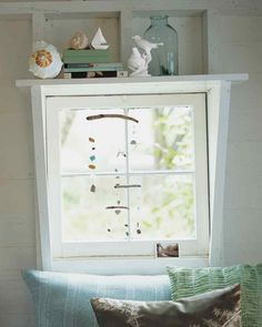 Sea-glass pieces and ceramic shards, another beach find, can be combined in a Calder-esque mobile, producing a charming effect when hung by a window. This mobile can be customized to include as many tiers or found objects as you like.