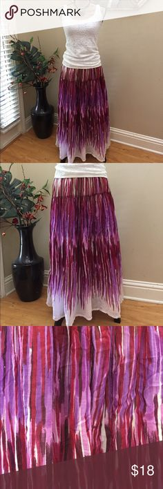 "🌺Ashley Stewart vibrant summer maxi skirt! 🌺Ashley Stewart vibrant summer maxi skirt! This is a pink plum lavender tan and white skirt that has a wonderful vibrant summer appeal. Lightweight and fully lined. Preloved in excellent condition. Elasticized waist lying flat is 15"". Lots of stretch. Length is 33"". Ashley Stewart Skirts Maxi"