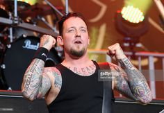 Michael Poulsen of the band Volbeat performs on stage during the final day of Rock Im Park Festival at Zeppelinfeld on June 6, 2010 in Nuremberg, Germany.