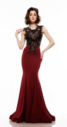 Johnathan Kayne Style 6044 from Johnathan Kayne has satin faced stretch jersey which seems to rise up elegantly from a fierce horse hair hemline on this fashion forward sleeveless gown detailed with an embroidered patent leather lace bodice embellished with black diamond crystals. Open lace-up back.