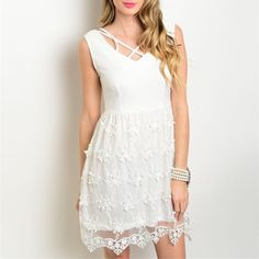 Stunning white chiffon/crochet overlay dress!⚡️ This elegant piece is fully lined and features an empire waist with pretty criss cross top with a flowy chiffon and crochet floral overlay!  Follow me on Instagram @kfab333 for more items Dresses
