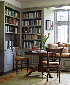 15 Small Home Libraries That Make a Big Impact From the lovely reading table to the natural light and window seat, this is a home library with heart. Cozy Home Library, Home Library Rooms, Home Library Design, Library Ideas, Library Corner, Library Inspiration, Library Wall, Dream Library, Home Study Rooms