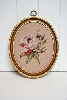 Set of 4. These framed needlepoint roses are beautiful. Beautiful pinks, mauves and fuschias stand out against the pale pink background. The entire image was worked and has been done with a thicker yarn, not floss. Someone spent a lot of time on these! They have been mounted in oval frames that have a gold colored edging. These have not been professionally mounted and were most likely done by the maker. They are in excellent condition. No stains, rips or tears. SPECS: 14.5 inch...