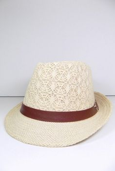 'Downton Abbey' Fedora - This fedora has just the right amount enough girly-ness and boho vibe with its crochet lace top! The hat features a medium wide brim with a faux leather brown band with a buckle detail. If Lady Mary was around, we think she would style herself in this natural colored 'Downton Abbey' fedora. Available in natural. Crochet detail. Imported.