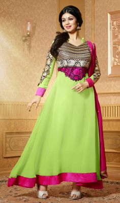 Freshen up the boring mood and dress up like Ayesha Takia in this lemon green shade faux georgette long Anarkali suit. Kameez is prettified with decorative and embroidered foliage patterned patches on the yoke part. Contrasting asymmetrical hemline patch evokes simplistic charm of the attire. #AnarkaliDress