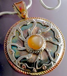 I& been making mandala forms in jewelry for a long time, probably over 45 years. And before that I drew and painted them starting in . Mixed Metal Jewelry, Layered Jewelry, Wooden Jewelry, Copper Jewelry, Pendant Jewelry, Jewelry Art, Jewelry Design, Jewelry Ideas, Metal Jewellery