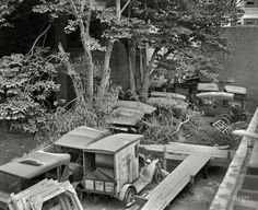 "Circa 1926. Continuing our back-alley tour of Washington, D.C. ""Ford Motor Co."" An urban junkyard. National Photo Company glass negative."