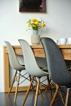 Gray and black chairs with wooden table