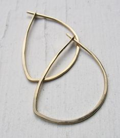 "Your choice of sterling silver or 14k gold fill for these delicate hand-shaped hoop variations. - earrings measure about 1-1/4"" long - choose 14k gold fill or recycled sterling silver"