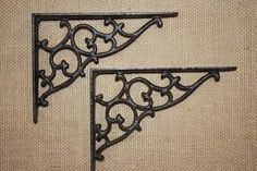 """Victorian medium shelf brackets B-1. Shelf Bracket Material: Cast Iron. Hand-cast . Shelf Bracket Color: Rustic brown . Shelf Bracket Size: Approx. 5 3/8"""" X 7 1/8"""". These are lovely and rustic and finished in a nice rustic brown color. 