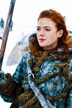 Ygritte.  Though only in a few episodes, she quickly became my favorite.  She believes in women being strong and people being free.  She gets captured and mocks the person holding her hostage.  She makes a joke out of situations and loves stronger than any other person in the entire show.  An underrated character.