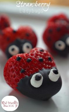 Heart shaped Chocolate Covered Strawberry Ladybugs for a fun food treat on Valentine's Day, Spring, Summer, Fairy Garden Parties or any day! Easy, Fun and delicious. Kids love 'em! www.kidfriendlythingstodo.com #summerfunfood #fairypartyfoodidea #springfunfoodidea #valentinesdayfoodidea #gardenpartyidea