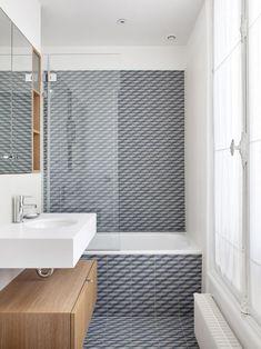 Tiled bathroom in Paris apartment.