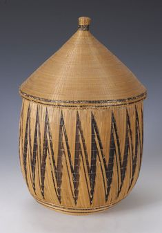 Africa | Large Lidded Tutsi basket. Tutsi tribe, Rwanda or Burundi | Circa 1920's | Woven cane and fibre | Provenance:  Ex Belgian collection before 1935