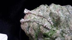 brinco de cristal e bolinhas  prata 925  com garantia  com 5 cristais e 4 bolinhas na ponta  com 4cm de altura R$ 48,99