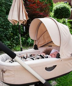 Beige melange #Stokke #Crusi carry cot keeps newborns safe, cozy & lifted closer to mom and dad too. #HigherIsBetter