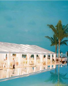 Clear-Topped Tent | Martha Stewart Weddings - At this wedding on the beach in the Maldives, guests sat down for dinner in a clear-topped tent that had poles draped with soft chiffon and chandeliers twined with white silk wisteria and capiz shells.