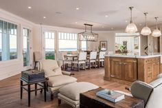 This traditional white gourmet kitchen is perfect for cooking, eating and relaxing. With lots of open windows and plenty of space to sit, you can enjoy the shoreline views no matter what you're doing.