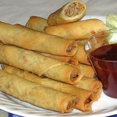 LUMPIA!  I use ground beef and leave off the green onions and cabbage.