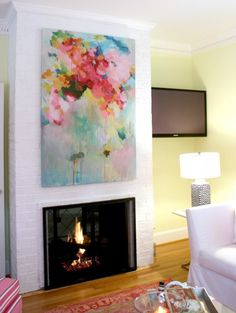 large abstract painting over fireplace, via Bright Bold Beautiful blog