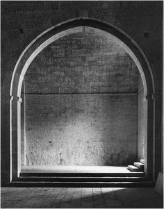 American photographer David Heald's Entrance to the South Aisle. Louis Kahn, the master of architecture and light, said that the sun needs architecture to show how great it was. Vice versa, architecture needs the sun to unlock its beauty. This picture shows just how right he was.
