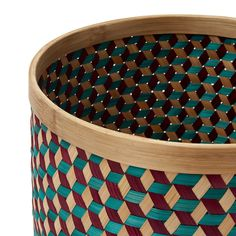 Dark red, Emerald green & natural, our  the 100% bamboo Arezzo Storage Basket is crafted by hand.