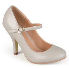 Step into classic style in these Mary Jane pumps by Journee Co These high-heel pumps feature matte faux leather uppers. A round toe design and straps with dainty buckle accents complete the look.