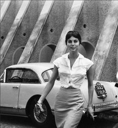Rare image of Ava Gardner ,behind one of her favorite speed cars.(1958).