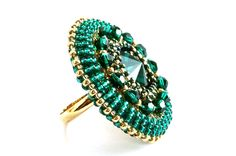 "Beaded Cocktail Ring - Swarovski Emerald Green Gold Beads. Beautiful emerald crystal seed beads complemented by gold beads intricately handbeaded into a circle, in the center sits a dazzling Swarovski emerald crystal stone surrounded by sparkling emerald crystals.   ~ The diameter of the ring is approximately 1.3"" or 35mm"