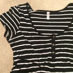 Striped T-shirt dress This dress is in great condition. It is super comfortable, with a cinched elastic waistband. There are loops for a belt. The material is stretchy. Xhilaration Dresses