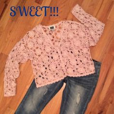 Floral Crochet Sweater w/Pearl Accents WW!!!  Super cute sweater. A light pink color with Pearl accents on the flowers. This is a regular size medium. Excellent condition!!!  Button closure. Studio Sweaters Cardigans