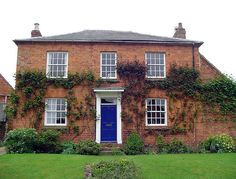 Victorian Red Brick House by jacqamoe, blue door with red brick        A bit daring but gives you an idea of bold door and with white trim