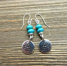 Turquoise stone and silver metal lotus flower charms and sterling silver earrings. Small handmade jewelry.