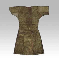 """Moshchevaya Balka - an archaeological site on the North Caucasus Silk Road"" Caftan of a chieftain, covered with Syrian silk featuring senmurvs Early 9th century Moshchevaya Balka burial ground, North-Western Caucasus, Stavropol Region Silk (samite), squirrel fur"