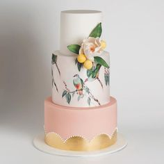 Pink and gold metallic cake with a bird.