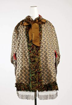 Date:     1883–87 Culture:     American (probably) Medium:     silk, feathers, metal Dimensions:     Length at CB: 17 1/2 in. (44.5 cm) Credit Line:     Gift of The New York Historical Society, 1979