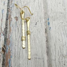 ~hand forged brass earrings~    ~ inspiration: the perfect balance sometimes found in asymmetry These earrings are hand-forged and textured from raw