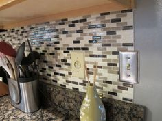 Peel and stick: Smart Tiles.  Great for backsplash and it can be removed by using a hairdryer