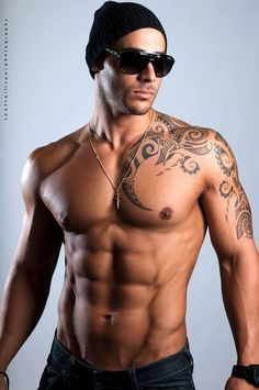 Risultati immagini per male chest tribal tattoos