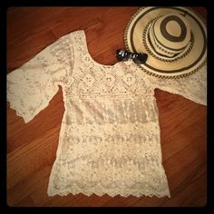 BEAUTIFUL LACE TOP Beautiful and delicate lace top. Wear it with a tank top under for a nice and chic look. Loose Knit sheer top shirt. Body Central Tops Blouses